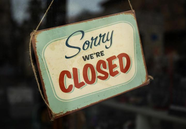"Sign that reads, ""Sorry we're closed"""